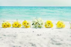 boquets..I just love the colors of the flowers and the ocean together