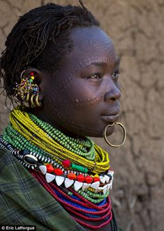 Africa   Toposa women with traditional facial markings.  South Sudan.   ©Eric Lafforgue. - fine combination of colours