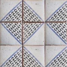Luxury hand-painted tile. Palio 1 royal blue & charcoal on off white