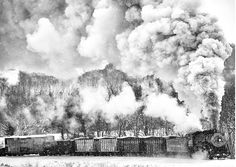 Powerful steel engines blowing huge, undulating clouds of smoke into the air emerge from the fog in these strikingly beautiful images by engineer and self-