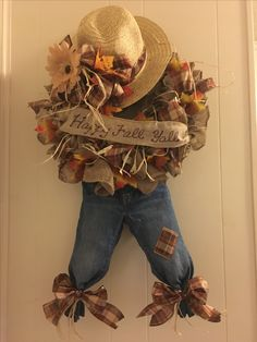 Fall Scarecrow Wreath.  This was fairly easy to make.  My first wreath using burlap and wire form.