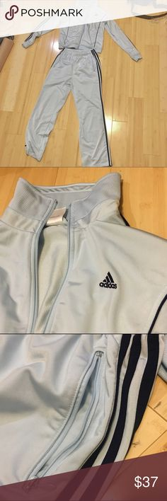 Adidas Adult Sweatsuit/Tracksuit Light Blue Gently used adidas tracksuit.  Unnoticeable pale yellow stain toward the foot of the pants. Clothes were much too big for me to wear. Light blue jacket with navy blue stripes. Jacket is a size Medium and the pants are Medium but really long (for my short legs). Adidas Jackets & Coats