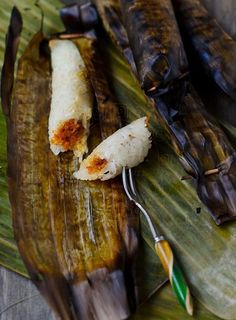Glutinous rice filled with savoury coconut, wrap in banana leaf, grilled to perfection