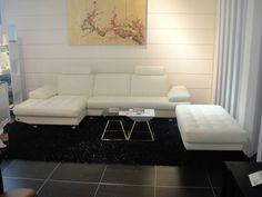 Stylish Design Furniture - Savannah Modern White Full Leather Sectional Sofa with Headrests and Ottoman, $3,150.00 (http://www.stylishdesignfurniture.com/products/savannah-modern-white-full-leather-sectional-sofa-with-headrests-and-ottoman.html)