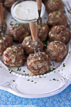 Spicy Jalapeño Cream Cheese Cocktail Meatballs - Spicy, little cocktail meatballs seasoned with PHILADELPHIA's new spicy jalapeño cream cheese, cheddar cheese, bacon and spices like chile powder and oregano with a homemade ranch dressing on the side for dipping. Inspired by jalapeño poppers. | http://www.cinnamonspiceandeverythingnice.com/jalapeno-cream-cheese-cocktail-meatballs/#ixzz2PwSJBsG4