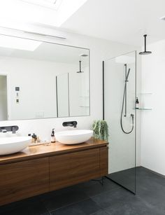 A custom-made timber vanity brings natural warmth to the crisp black and white bathroom. Photography by: Helen Bankers. Bathroom Renos, Master Bathroom, Remodel Bathroom, Bathroom Remodeling, Brown Bathroom, Ikea Bathroom, Bathroom Plants, Bathroom Ideas White, Modern White Bathroom