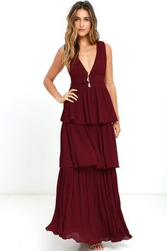 Dancing in the Gently Adrift Wine Red Maxi Dress is an absolute dream! A sleeveless bodice, with plunging V-neckline, tucks into a banded waist above a tiered maxi skirt, composed of accordion pleated, woven poly. Back slit buttons at top. Hidden back zipper/hook clasp.