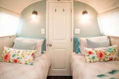 Two twin beds, wonderful bedding and comfortable mattresses.