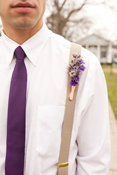 I like the white shirt with the purple tie and purple + green boutonniere for Michael. Groomsmen & bridesmaids will be in cobalt blue (dresses for girls, accents for guys) with white and green flowers.