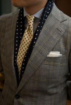 Beautiful tie, great scarf. Look good with the suit.