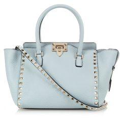 Valentino Rockstud medium leather cross-body bag ($2,245) ❤ liked on Polyvore featuring bags, handbags, shoulder bags, light blue, crossbody handbags, blue leather purse, crossbody shoulder bags, leather purse and genuine leather handbags