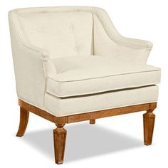 So comfy you will want this tub-shaped Cotillion Accent Chair for every room in the house. It features wooden base trim and tapered legs. Available in an easy-to-blend fabric. Customer assembly required. Magnolia Home designed by Joanna Gaines.