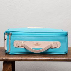 This great travel case easily holds larger items. Features inside zippered pocket. Zips three quarters around with a leather handle for easy carrying. Size: 4.5h x 12w x 8d
