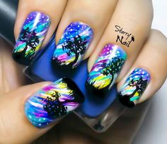 Galaxy nails done with an artist's touch.