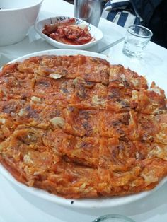 Korean Kimchi Pancake you can enjoy in Seoul, Korea....a Korean pub called So-Moon-Nan-Jeep,...Good for your health and  wellness of your body and mind...