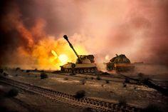 Kuwait War. Tanks pass through blazing desert