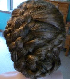 braided like a basket.perfect for heavy hair that does not hold curls.