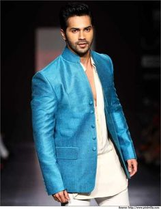 #VarunDhawan looked dapper in a white kurta Pajama with a stunning blue jacket