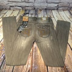 """INDUSTRIAL REVOLUTION DISTRESSED JEANS These are awesome and I'm so sad they didn't fit me. They are factory distressed with embellished pockets. The color is a taupe color. Kinda between a tan and gray. Love them INSEAM 31"""" Industrial Revolution Jeans Skinny"""