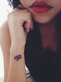 #minimal #Lotus #Flower #wrist #tattoo - A lovely flower that can grow in mud and dirty water.