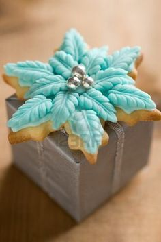 A large poinsettia cookie makes a pretty topper on a small package.  |  123RF