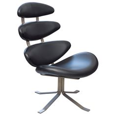 Poul M. Volther, Corona lounge chair, Four shells fully upholsered in black leather, brushed steel frame. Designed in 1962. Produced by Erik Jørgensen.