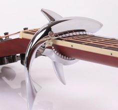 instrument accessories Picture - More Detailed Picture about Yuker Shark Guitar Capo Zinc Alloy Quick Change Clamp For Acoustic Classic Electric Guitarra Musical Instrument Accessories Picture in Guitar Parts & Accessories from Yuker Tiptop Store Acoustic Guitar Case, Guitar Neck, Guitar Accessories, Silver Accessories, Bass Guitar Lessons, Guitar Parts, Playing Guitar, Musical Instruments, Musicals