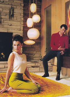 Goodness, what might this retro-esque housewife be thinking? Nelson bubble lamps featured in Esquire, 1997. via