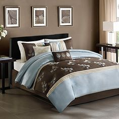Update your bedroom's décor with the unique Regency Heights Tory Duvet Cover Set. The stylish bedding features a soft blue polyoni pieced with beige pleating and an embroidered leaf pattern on a chocolate brown ground.