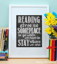 Free Reading Printable - So cute! Would be perfect to hang in a reading nook.