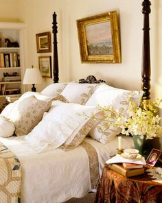 Beautiful bedroom...love the skirted side table, poster bed, artwork, bedding, bookshelves.....and did I say that it's very English, my favorite