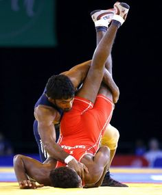 Yogeshwar Dutt of India, left, wrestles with Chamara Perera of Sri Lanka during a men's FS 65kg semifinal wrestling bout at the Scottish Exhibition Conference Centre during the Commonwealth Games 2014 in Glasgow, Scotland, Thursday July 31, 2014. (AP Photo/Kirsty Wigglesworth)