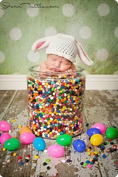 Baby in Jelly Beans. The infant can sit in this big jar and then filled it with jelly beans. The best time to get this shot is to put one jelly bean into its mouth. Make sure that your baby is old enough to eat it.
