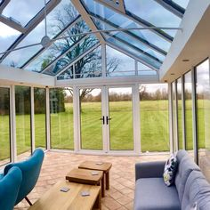 Modern aluminium all glass conservatory built on a traditional stone hiuse, with inset spotlights and internal plastered pelmets