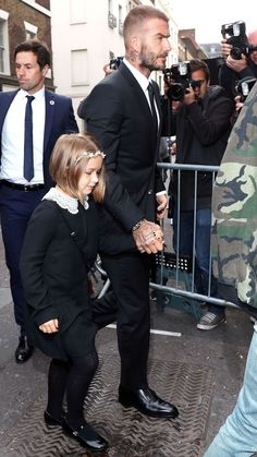 Victoria and David Beckham's daughter Harper Beckham attended her mother's London Fashion Week 2018 show looking so cute. See her outfit here. David Beckham Daughter, David Beckham Style, David Beckham 2018, Victoria And David, David And Victoria Beckham, London Fashion Week 2018, Harper Beckham, Father And Baby, Undercut Hairstyles