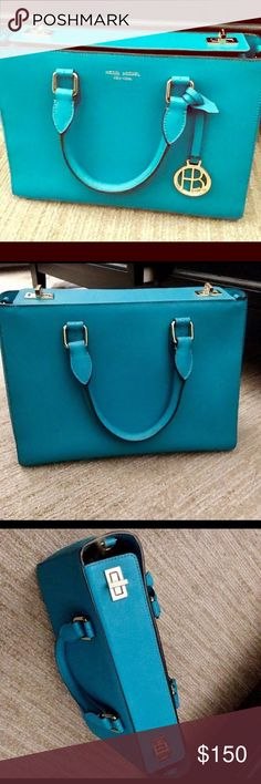 Authentic Teal Henri Bendel Bag Authentic Henri Bendel Bag. Purchased at HB Boutique Store in 2016. Excellent condition. Teal and Gold in Color. Henri Bendel logo on clasps, outside, on charm, and interior. Comes with strap, charm, dustbag, and authenticity card. henri bendel Bags Satchels