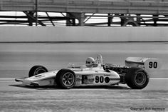 "Rick Mears, making his rookie appearance at the Indianapolis Motor Speedway, drives his Eagle 7225/Offenhauser TC on a warmup lap during practice for the 1977 ""500."" Mears failed to qualify for the '77 race, but returned the next year with Roger Penske and went on to win four races in the next 15 years."