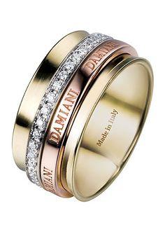 """Anillo de la colección """"Twister"""" compuesto por varios aros de oro amarillo, blanco y rosa con diamantes, de Damiani."""