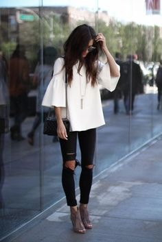 white ruffle sleeve + ripped black jeans