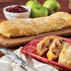 Autumn Apple Strudel Recipe Desserts with eggs, water, granulated sugar, all-purpose flour, ground cinnamon, granny smith apples, dried cranberries, pepperidge farm puff pastry sheets, decorating sugars