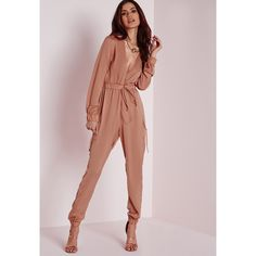 Missguided Satin Long Sleeve Jumpsuit ($68) ❤ liked on Polyvore featuring jumpsuits, blush, plunge jumpsuit, plunging v neck jumpsuit, long sleeve jumpsuit, satin jumpsuit and jump suit