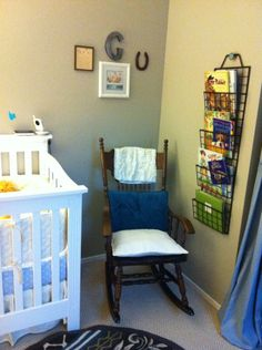 Love the way they have the books on the wall and the  placement of the chair.  Easy to put a baby to sleep