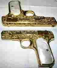 Gold scrolled handgun w/pearl grips