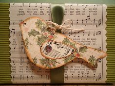 handmade Christmas tag ... Old Fashioned Holly Bird Tags ... would make a great card topper ... recycled or Vintage look prints ... bird die cut from Christmas paper ... wing and background from old sheet music .... luv it!!