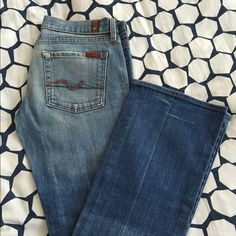 7 for all mankind straight leg jeans Gently worn (shown) 7 for all mankind denim jeans. Small hole in crotch/thigh area that can't be seen when worn and can easily be fixed with a denim patch on the inside. (Offers considered) 7 for all Mankind Jeans Straight Leg