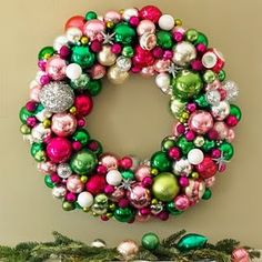 Festive Holiday Wreath... I like how they used varying sizes of the glass ornaments