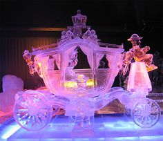 Unbelievably detailed ice sculpture of a carriage and it's passengers.