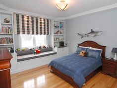 boys bedroom ideas | Blue Boys Bedroom with Window Seat and Built In Bookcases : Designers ...