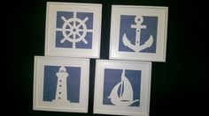 kit quadros de marinheiro, sendo 1 ancora, 1 manche, 1 farol e 1 barco, pintados de branco laqueado e forrado de azul com bolinhas.