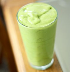 1/2 cup Frozen mango slices, 1 banana, a handful of spinach, and a little bit of vanilla almond milk. YUM!